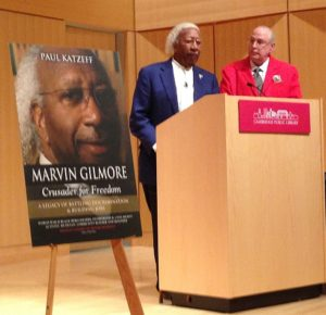 Marvin (left) and Paul share a podium at the Cambridge Public Library.