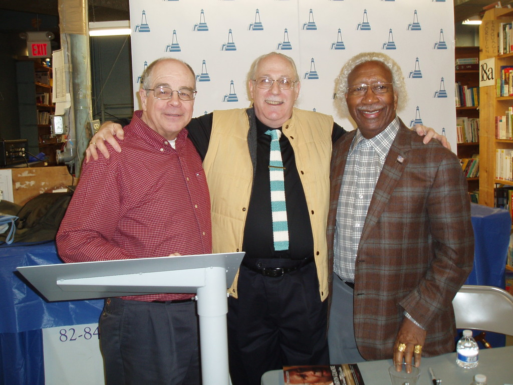 Paul (center) at his reading-signing at New England Mobile Book Fair, in Newton, with store owner Tom Lyons (left) and Marvin (right)