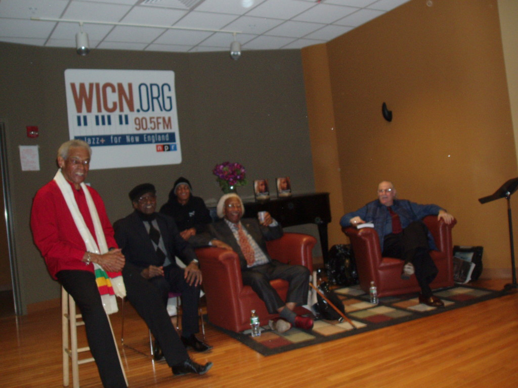 In the WICN-FM studio, seated in armchairs, Marvin (center) and Paul take a question from a member of the studio audience.